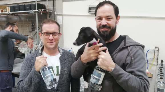 Liam, Danny, and Dizzy the dog from Circumstance Distillery celebrate the launch of the world's first AI gin.