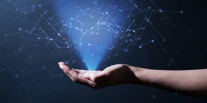 Woman's hand showing digital big data.