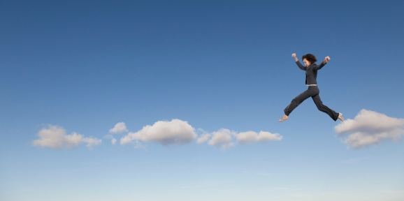 Illustration of a woman in a suit hopping across clouds in a blue sky