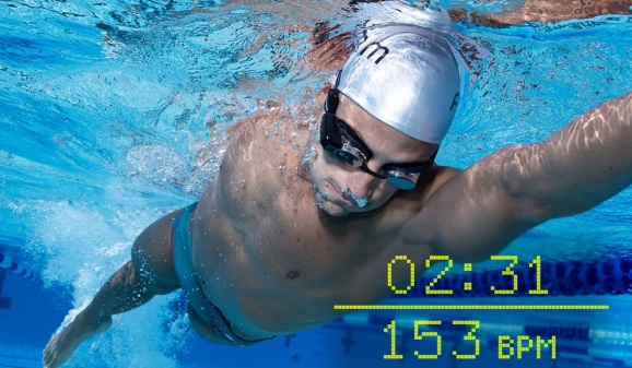 Man swimming with AR swim goggles, with timer and heart rate overlaid on picture