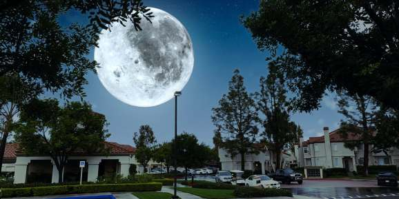 Live composite of supermoon over a neighborhood created by AI in Photoshop Camera