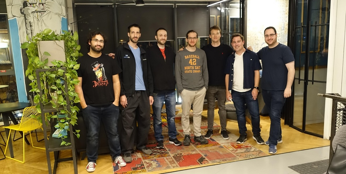 Scott Montgomerie (second from right), CEO of Scope AR, with members of WakingApp team.