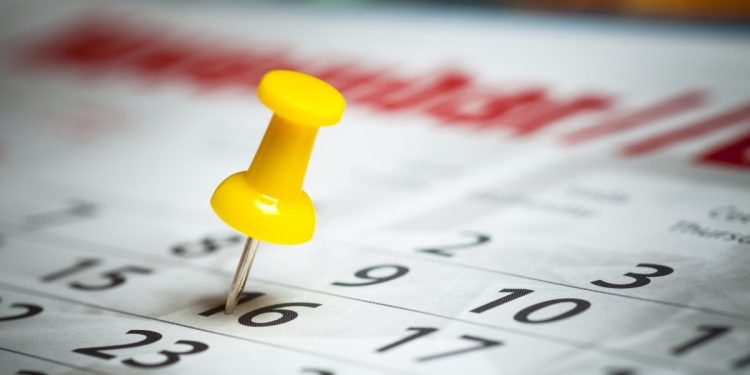 Calendar date marked by a push pin