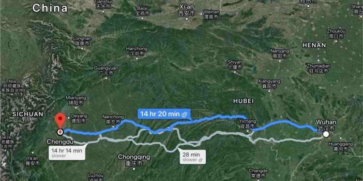 A map shows the 1,155-kilometer (718-mile) distance between doctors in Chengdu and coronavirus patients in Wuhan, China.