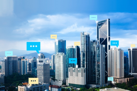 a high-rise city scape with text bubbles above several of the buildings