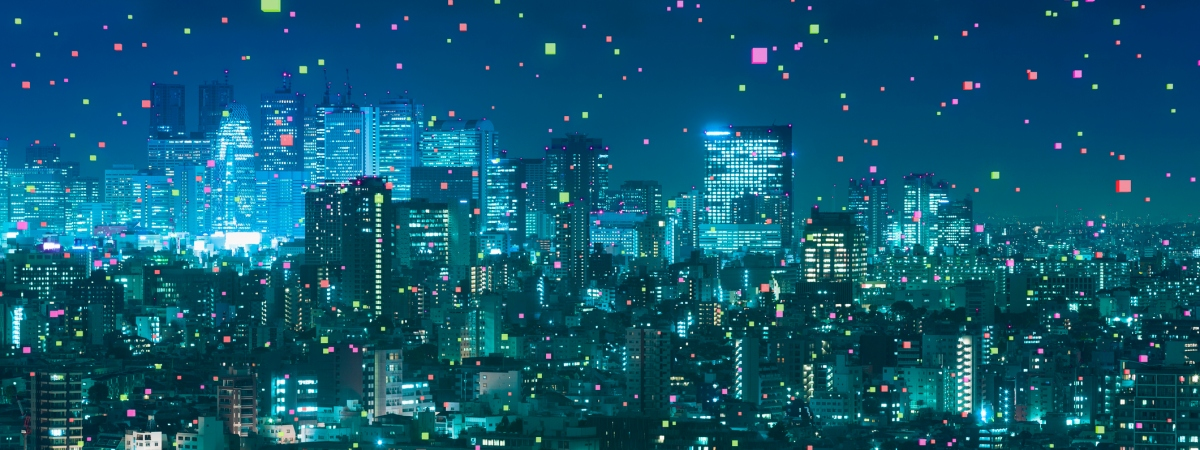 A cityscape at night with points of colored light scattered everywhere