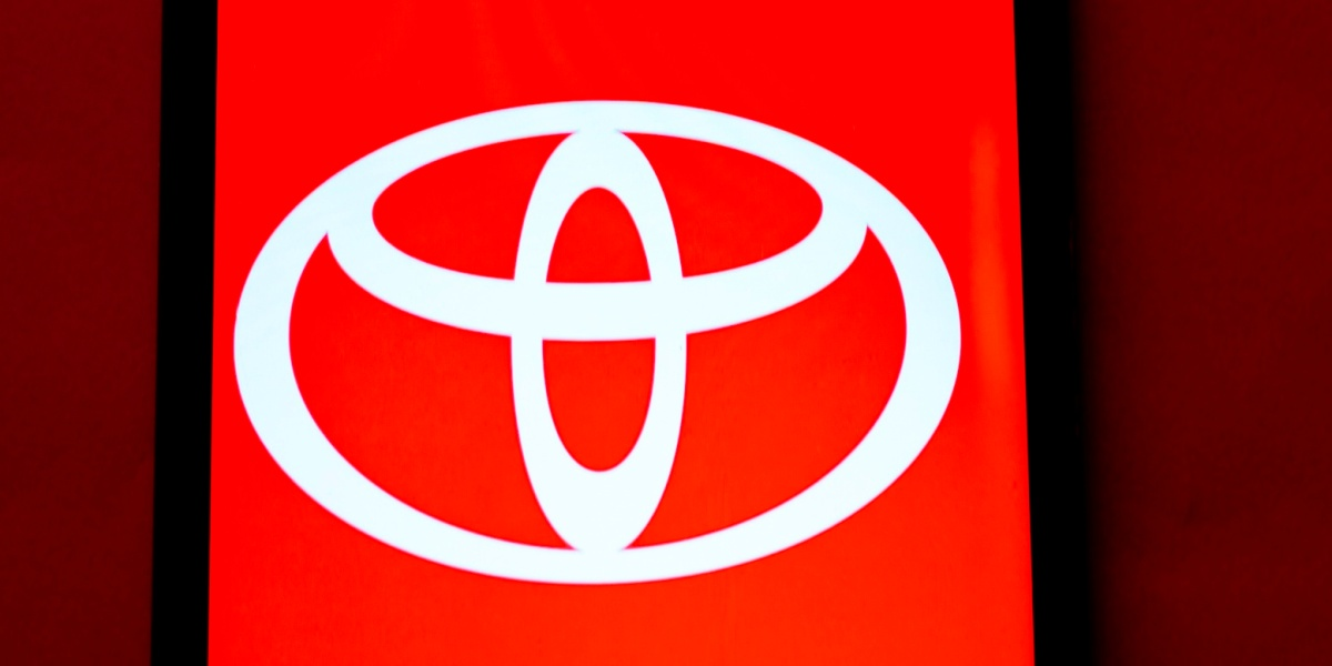 In this photo illustration a Toyota logo seen displayed on a smartphone.