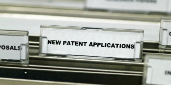 Close-up of the label for a suspension file for new patent applications in a filing cabinet