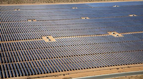 FILE PHOTO: An array of solar panels is seen in the desert near Victorville, California, U.S. March 28, 2018.