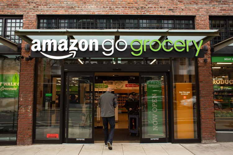 SEATTLE, WA - FEBRUARY 26: A shopper enters Amazon Go Grocery on February 26, 2020 in Seattle, Washington. The store in Seattle's Capitol Hill neighborhood is Amazon's first large retail grocery location that uses the cashier-free model.