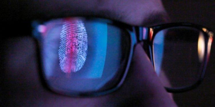 Fingerprint reflected in eyeglasses