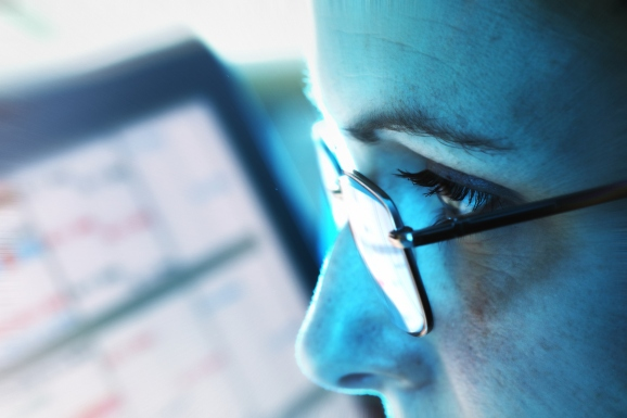 A female executive analyzes details on a screen