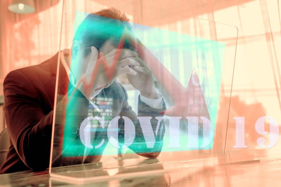 Concept of financial problems. Man holding his head while the markets plunge.
