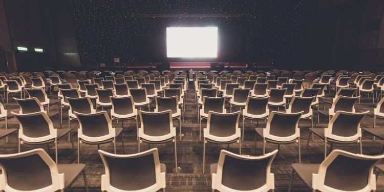 Empty chairs for audience in the conference hall