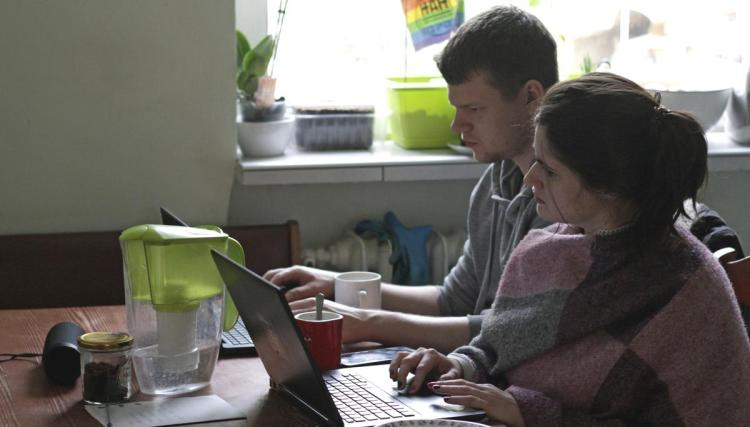 Two people work from home during the outbreak of coronavirus disease (COVID-19), in Gdynia, Poland, March 16, 2020.