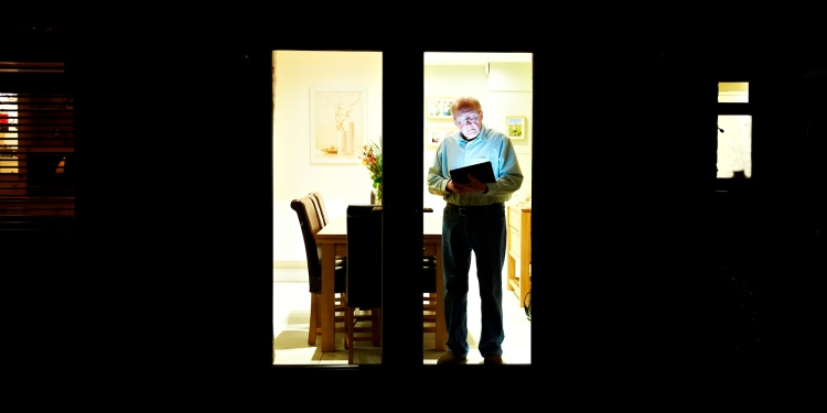An elderly person using a tablet