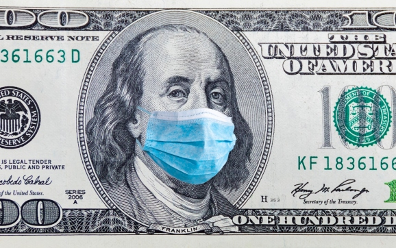100 dollar banknote with medical mask.