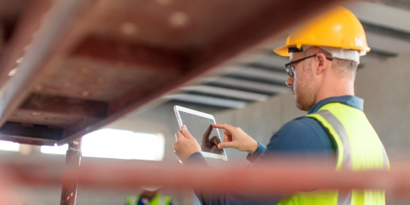 Architect using a tablet at construction site