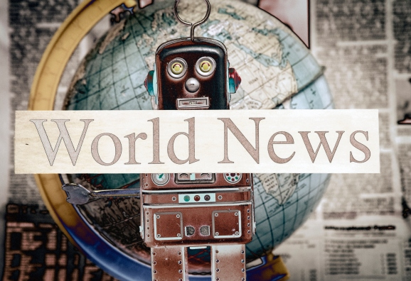 tin bot holding up a 'world news' sign