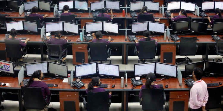 Employees wearing protective masks work inside a call centre run by Uttar Pradesh state police during an extended lockdown to slow the spreading of coronavirus disease (COVID-19) in Lucknow, India