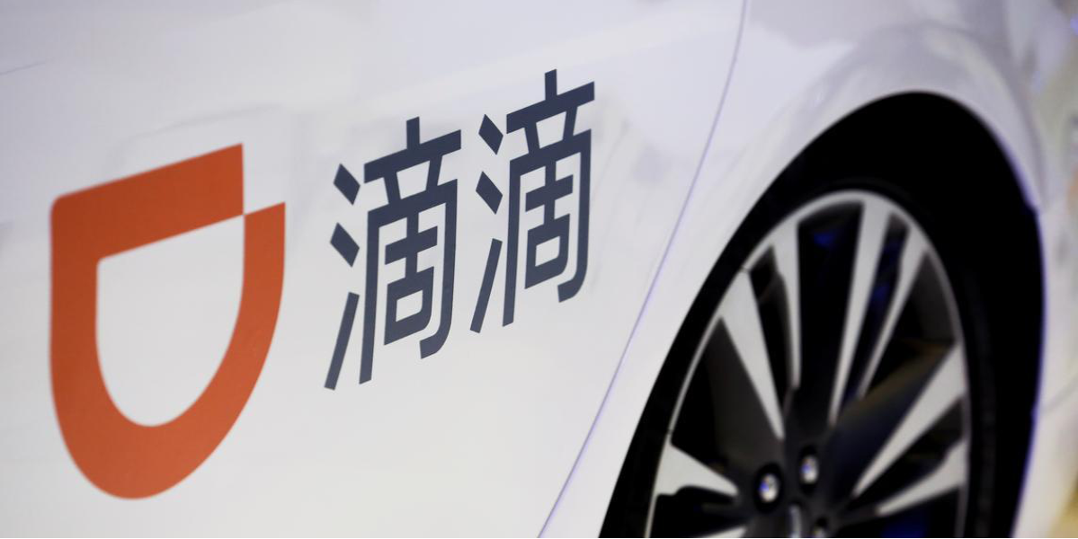 The company logo of the Didi ride-hailing app on a car door at the IEEV New Energy Vehicles Exhibition in Beijing, China, October 18, 2018.