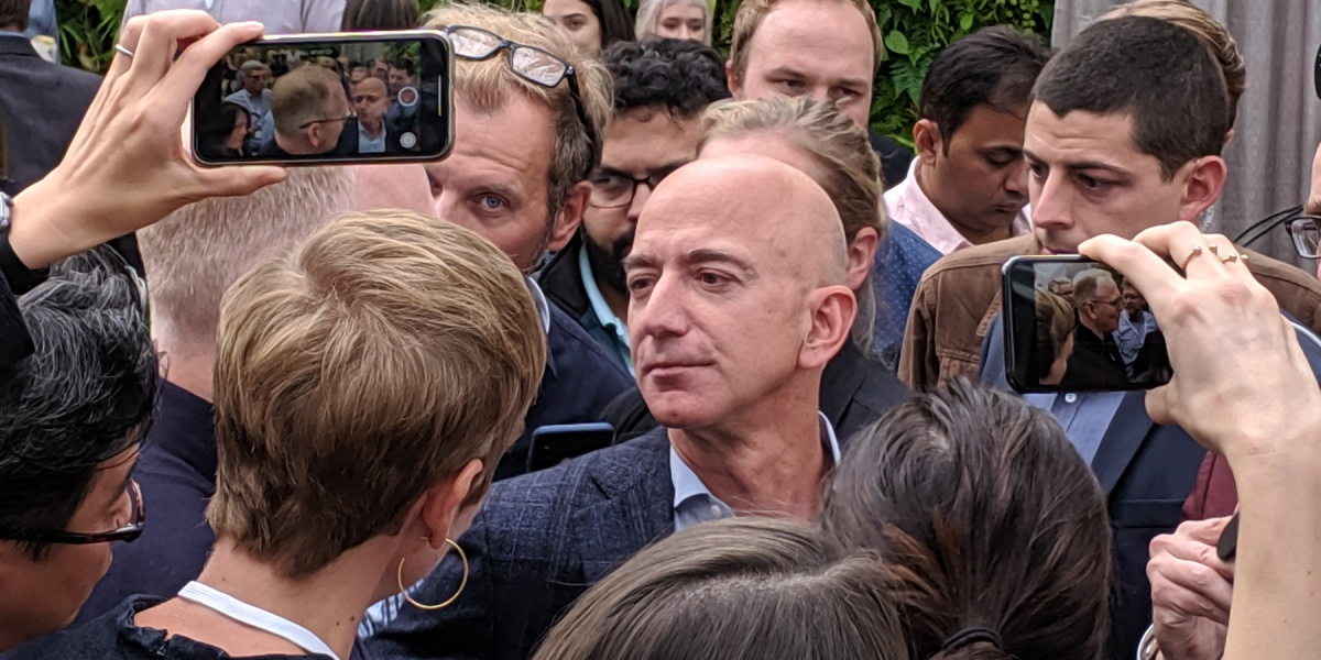 Amazon CEO Jeff Bezos answers questions from reporters at an Alexa event at company headquarters in Seattle, Washington