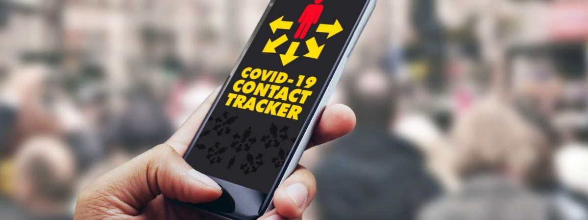 hand holding a smartphone with a contact tracing app loaded, on busy sidewalk