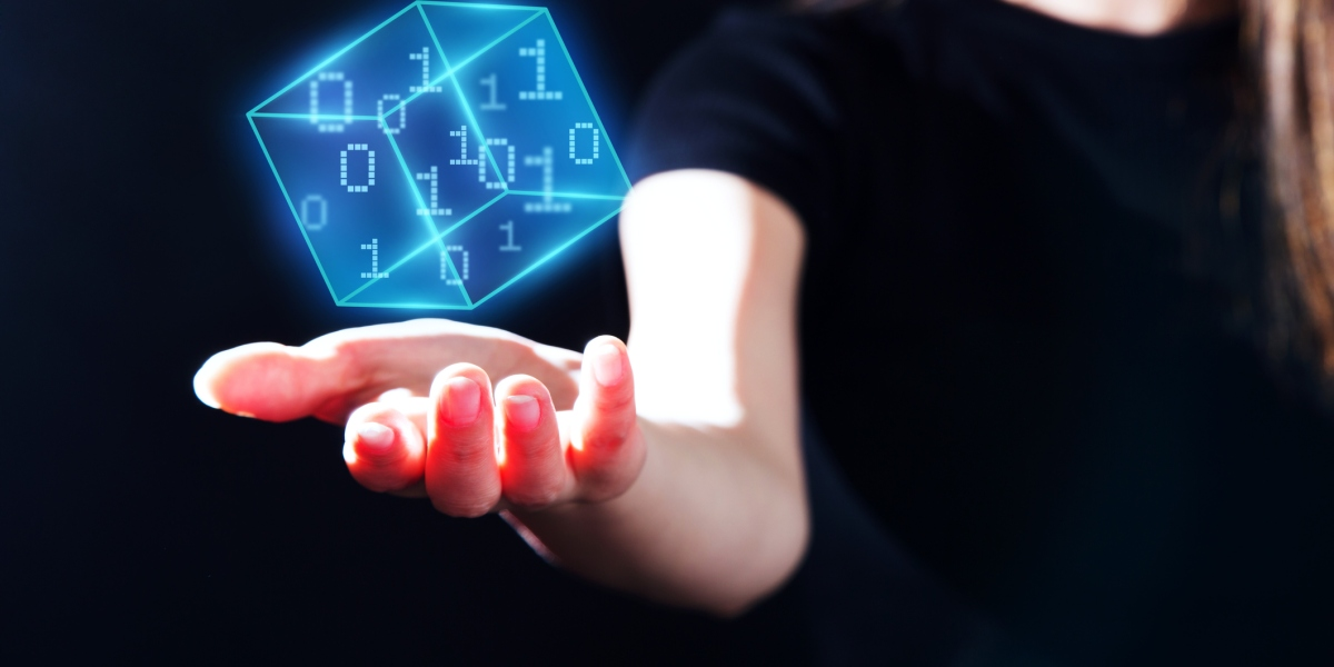 Woman's hand showing a digital cubic with a pixel binary numbers data.