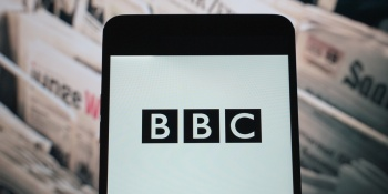 The logo of BBC is seen displayed on a smartphone
