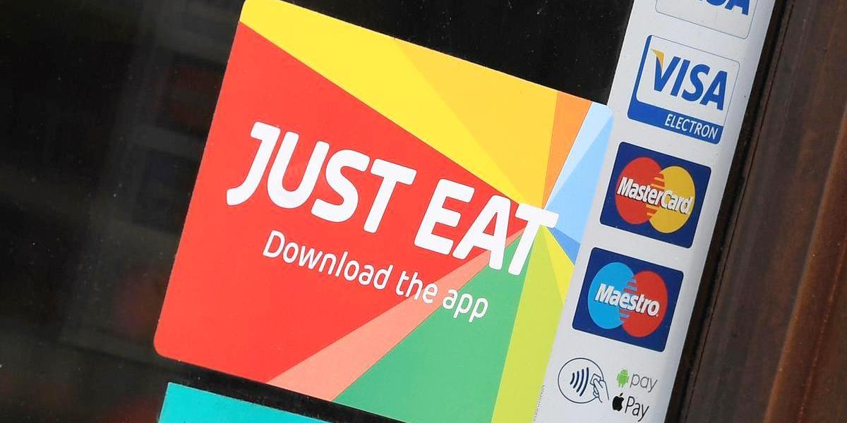 Signage for Just Eat is seen on the window of a restaurant in London, Britain, August 5, 2019.