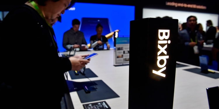 LAS VEGAS, NEVADA - JANUARY 8: Attendees examine Bixby-enabled devices at the Samsung booth during CES 2019 at the Las Vegas Convention Center on January 8, 2019