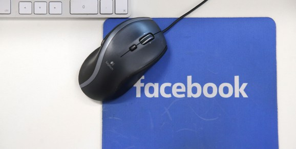 A mousepad with the Facebook logo is seen at Facebook's new headquarters, designed by Canadian-born American architect Frank Gehry, at Rathbone Place in central London on December 4, 2017.