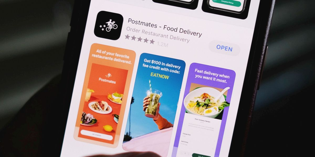 Illustration photo taken on June 30, 2020 shows the logo of delivery app Postmates on a smartphone screen in Los Angeles.