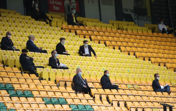 NORWICH, ENGLAND - JULY 11: People look on from the stands whilst social distancing during the Premier League match between Norwich City and West Ham United at Carrow Road on July 11, 2020 in Norwich, England. Football Stadiums around Europe remain empty due to the Coronavirus Pandemic as Government social distancing laws prohibit fans inside venues resulting in all fixtures being played behind closed doors.</body></html>