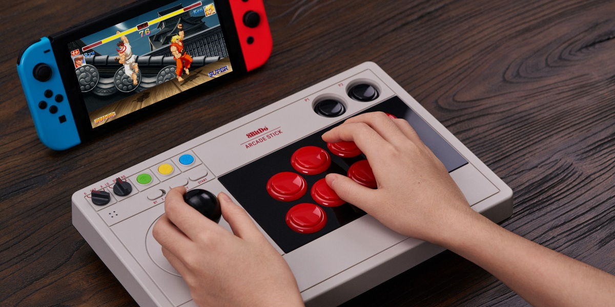 The 8BitDo Arcade Stick works with Switch and PC.