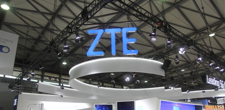 SHANGHAI, CHINA - JUNE 26: People visit the ZTE booth on day one of the Mobile World Congress (MWC)