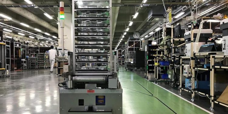 A self-driving vehicle with parts is pictued at Ricoh?fs photocopier components factory in Atsugi, Kanagawa prefecture, Japan July 13, 2020.