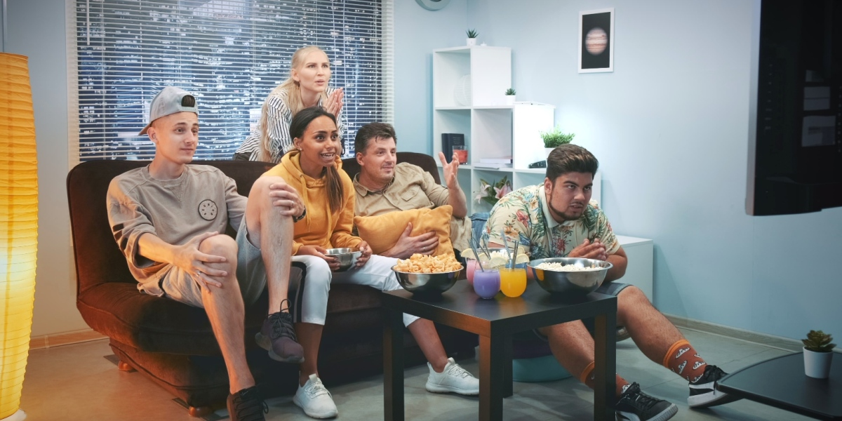 Group Of friends watching sports on TV