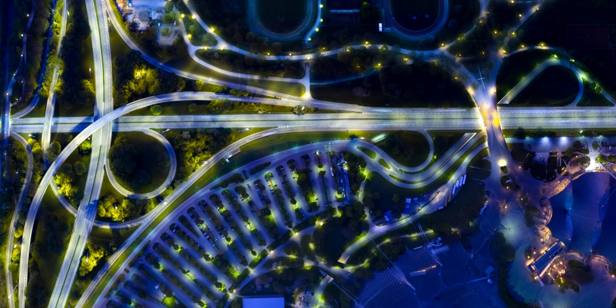 Bird's eye view, aerial view or overhead view of a city at night. Germany, Bavaria, Munich. Highway, streets, parking lot