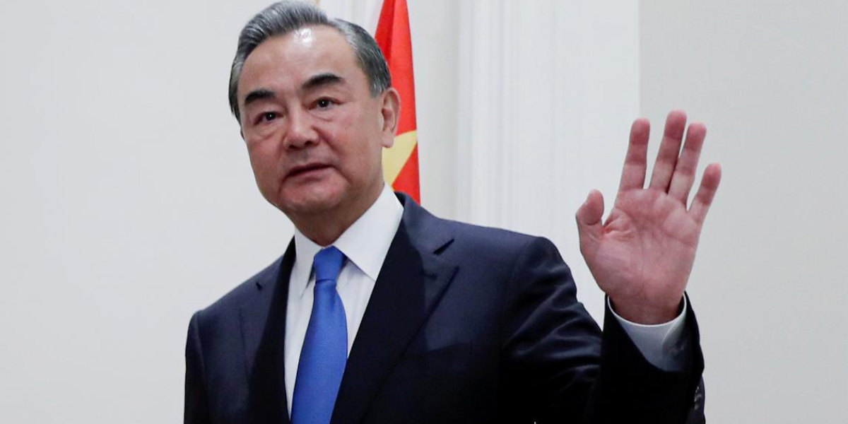 FILE PHOTO: China's State Councillor Wang Yi gestures as he meets with Canada's Foreign Minister Francois-Philippe Champagne in Rome, Italy, August 25, 2020.