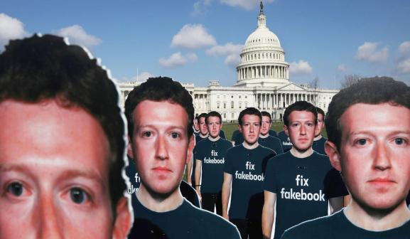 Dozens of cardboard cut-outs of Facebook CEO Mark Zuckerberg sit outside of the U.S. Capitol Building as part of an Avaaz.org protest in Washington, U.S., April 10, 2018.