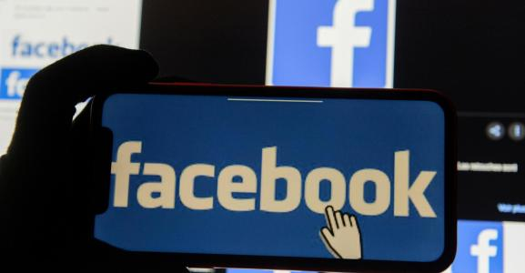 The Facebook logo is displayed on a mobile phone in this picture illustration taken December 2, 2019.