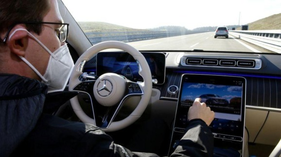 An employee of Daimler demonstrates steering by the Drive Pilot Level 3 autonomous driving system in a new Mercedes-Benz S-Class limousine on the company's test center near Immendingen, Germany October 14, 2020.