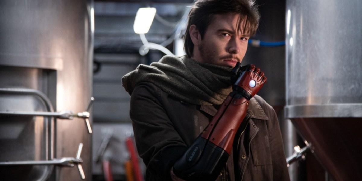 Daniel Melville gets a Metal Gear Solid bionic arm.