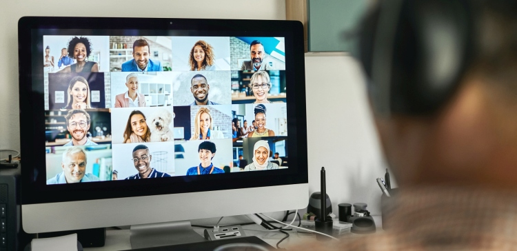 Businessman working with colleague through video conferencing -