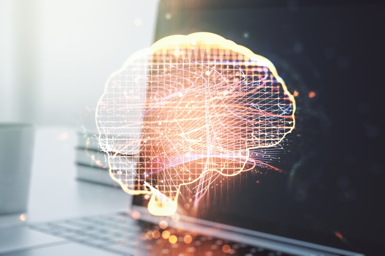 a digital brain projected over a laptop