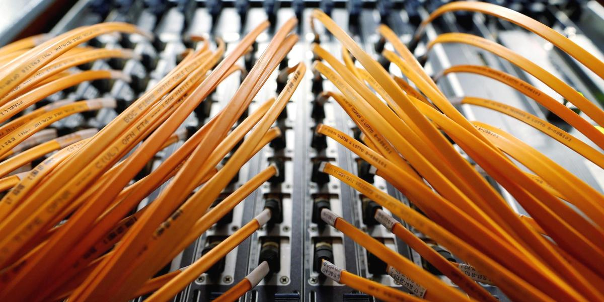 Optical fibre cables are seen in a telephone exchange in Rome, Italy December 20, 2013.