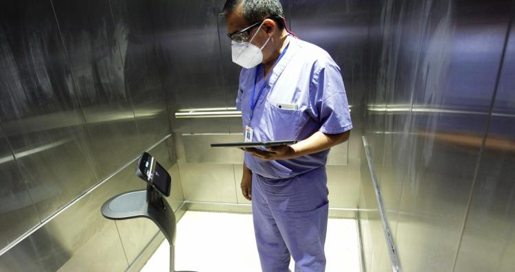 A healthcare worker uses a robot to carry out consultations with patients suffering from the coronavirus disease, at NOVA hospital in Monterrey, Mexico August 18, 2020. Picture taken August 18, 2020.