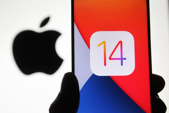 Photo illustration of the iOS 14 logo of the iOS mobile