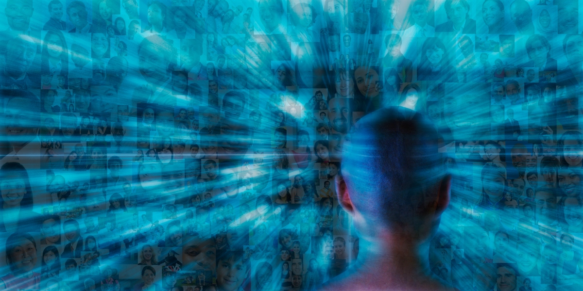 Hundreds of social media portraits zoom past a futuristic person monitoring the crowd.